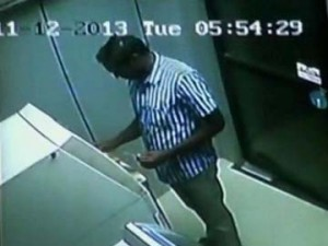 CCTV footage of a man resembling the attacker of a woman bank officer at an ATM kiosk